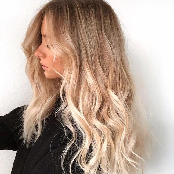 Side profile photo of woman with foilyage blonde hair, created using Wella Professionals