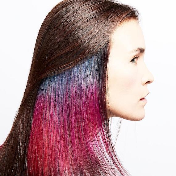 Woman with straight brown hair with hidden pink and purple hair color