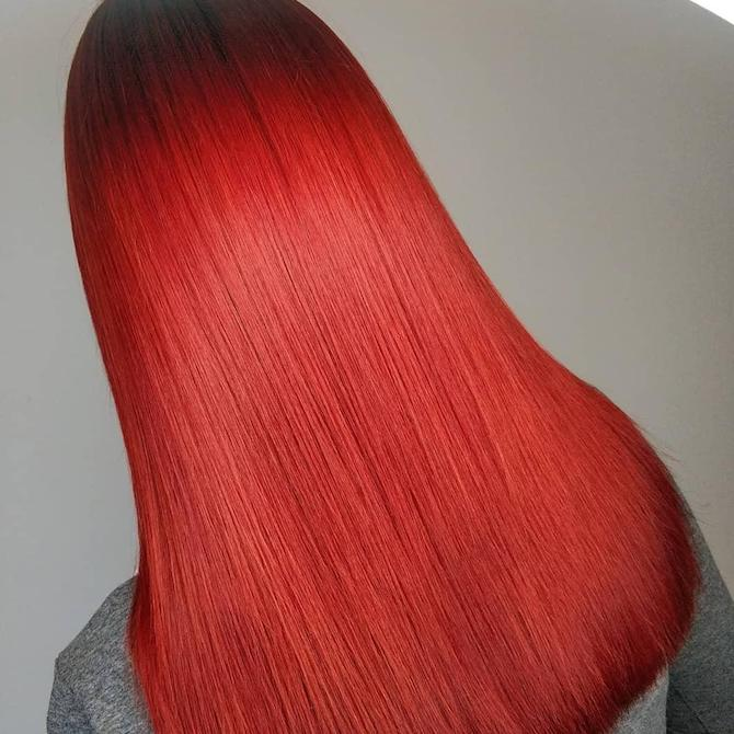Photo of long, straight, cherry red hair, created using Wella Professionals.
