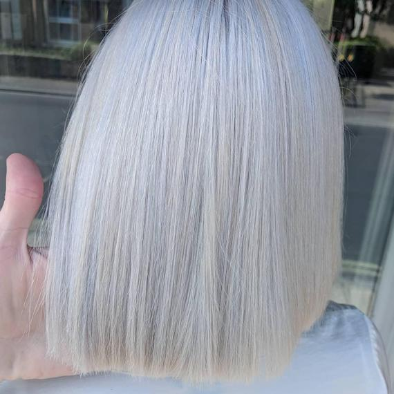 Woman with blonde and pastel blue bob