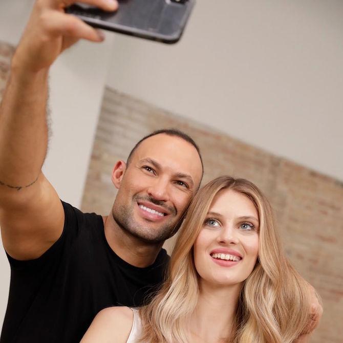 Wella Professionals Global Ambassador Romeu Felipe taking a selfie with a model.