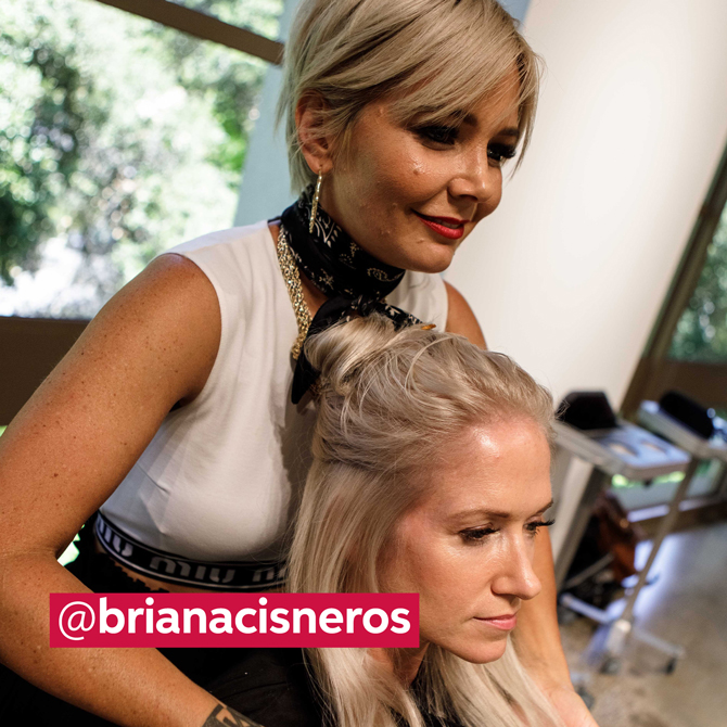 Blonde client with stylist stood behind her