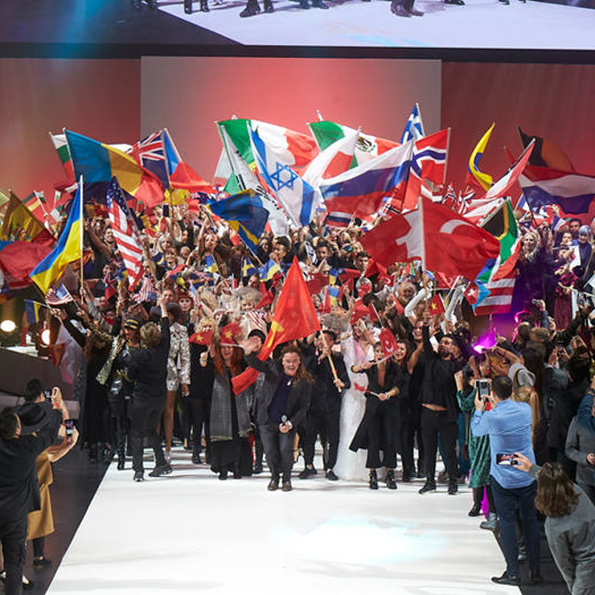 Group of people with flags from different countries