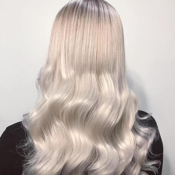 Photo of the back of a woman's head with long ice blonde hair, created using Wella Professionals