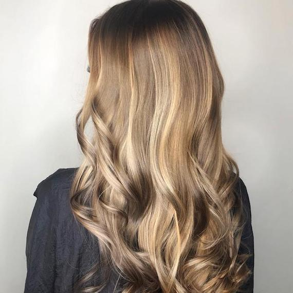 Side profile photo of woman with dark blonde hair, created using Wella Professionals