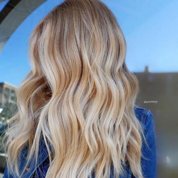 Woman with butter blonde hair, created using Wella Professionals