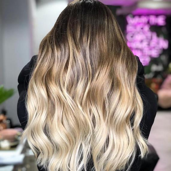 Back of a woman's head with blonde ombre hair, created using Wella Professionals