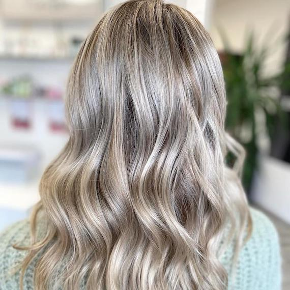 Back of woman's head with ash blonde hair, created using Wella Professionals