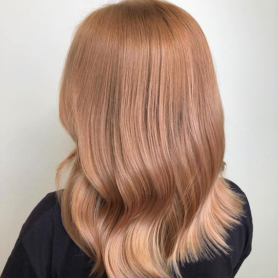 Photo of the back of a woman's head with strawberry blonde hair, created using Wella Professionals