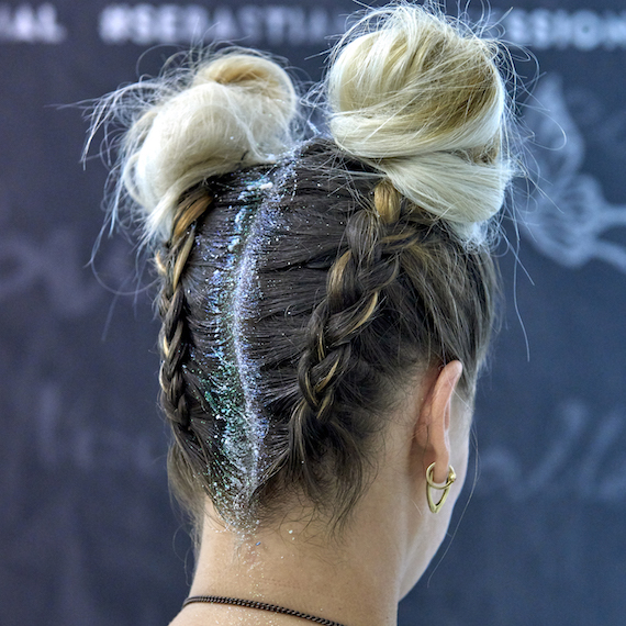 Side profile of model wearing braided ponytail and glitter roots, created using Wella Professionals