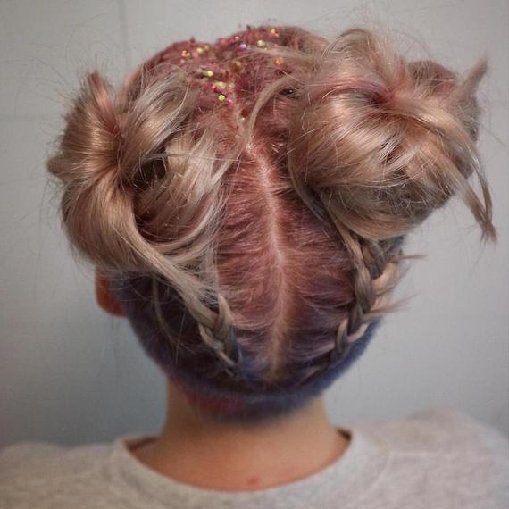 Close-up of model wearing braided space buns and glitter roots, created using Wella Professionals