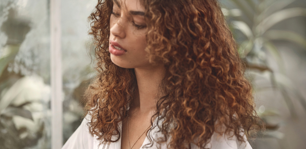 Model with curly hair, styled using Wella Professionals products