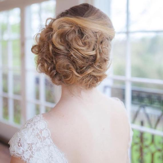Photo of a bride wearing a chignon wedding hairstyle, created using Wella Professionals