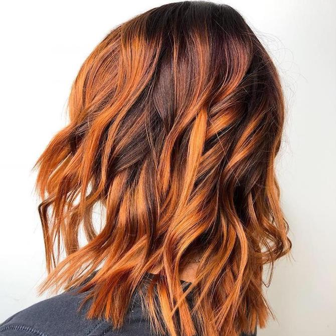Woman with pumpkin spice wavy hair