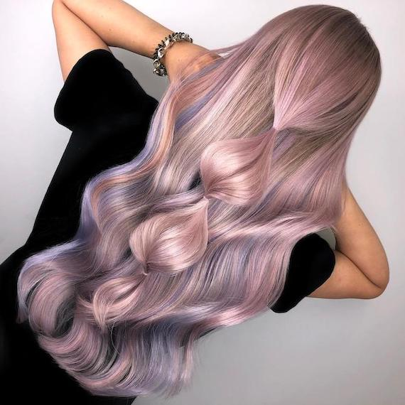 Back of woman's head with waist-length, pastel-colored hair, created using Wella Professionals.