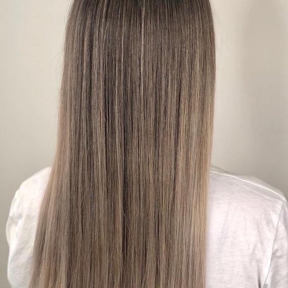Photo of the back of a woman's head with long, light ash brown hair, created using Wella Professionals.
