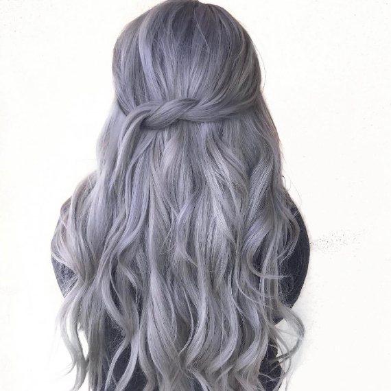 back of woman's head with long, purple ash gray hair