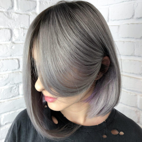 woman with long bob hair in warm ash gray color