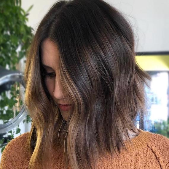 Woman with cold brew brown hair, created using Wella Professionals.