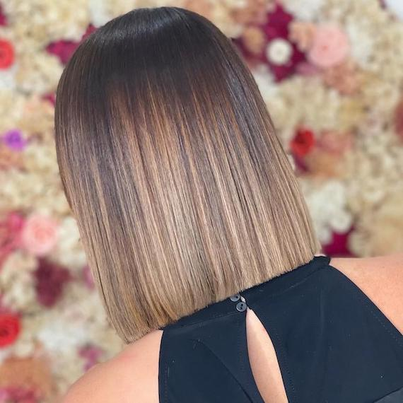 Back of woman's head with brunette balayage, created using Wella Professionals.