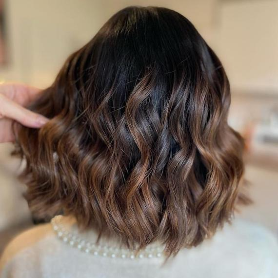 Back of woman's head with a brunette bob and balayage, created using Wella Professionals.