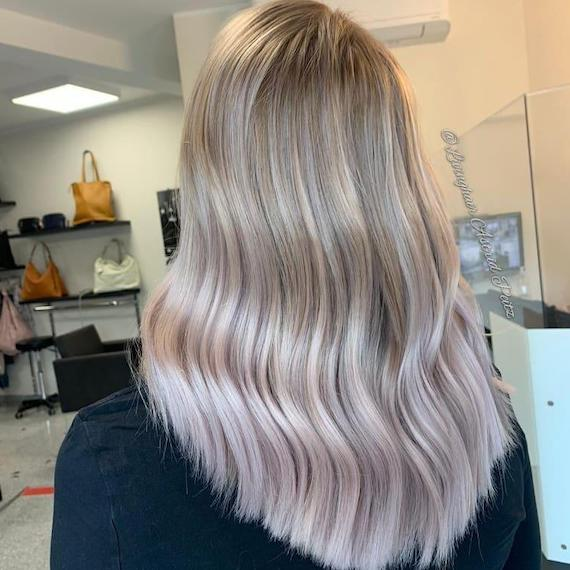 Back of woman's head with lilac frost balayage through straight hair, created using Wella Professionals.