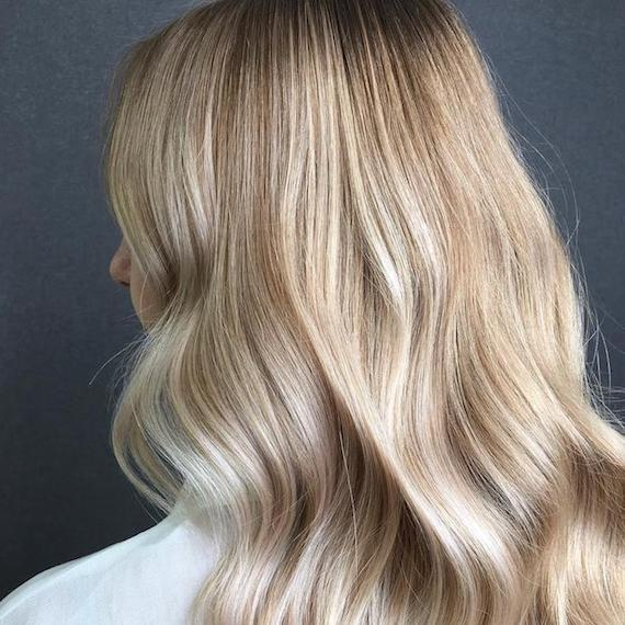 Babylights on long, wavy hair, created using Wella Professionals.