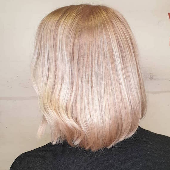 Photo of the back of a woman's head with short blush blonde hair, created using Wella Professionals.