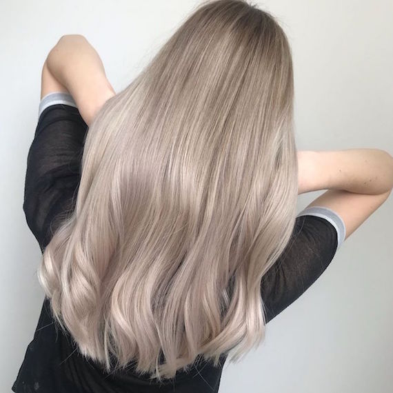 Photo of the back of a woman's head with long gray blonde hair, created using Wella Professionals.