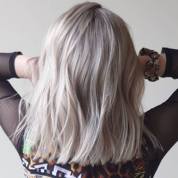 Photo of the back of a woman's head with mid-length platinum blonde hair, created using Wella Professionals.