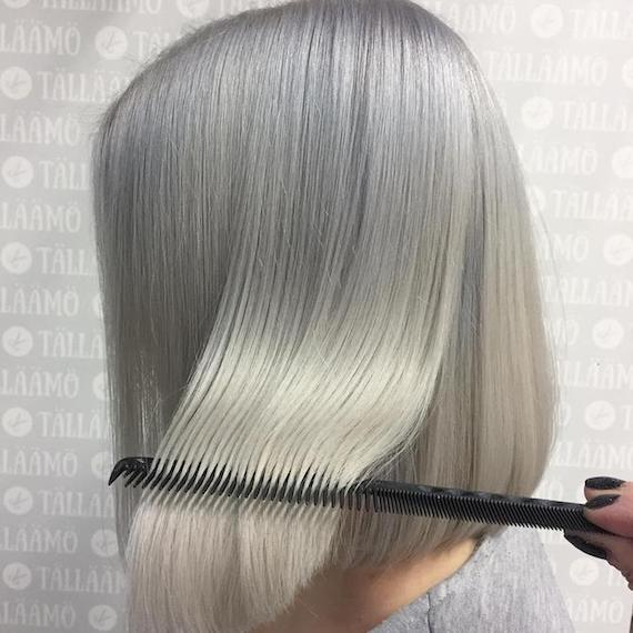 Woman with classic, blonde bob, created using Wella Professionals