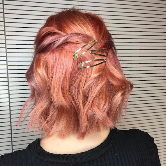 Woman with short, peachy bob, created using Wella Professionals