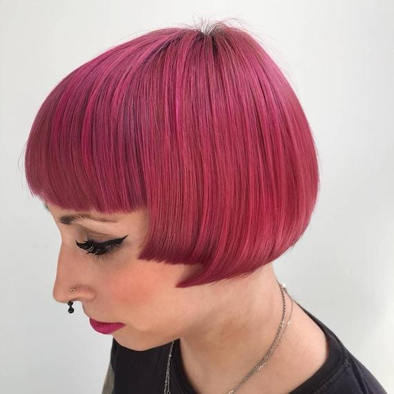 Woman with pink micro bob, created using Wella Professionals