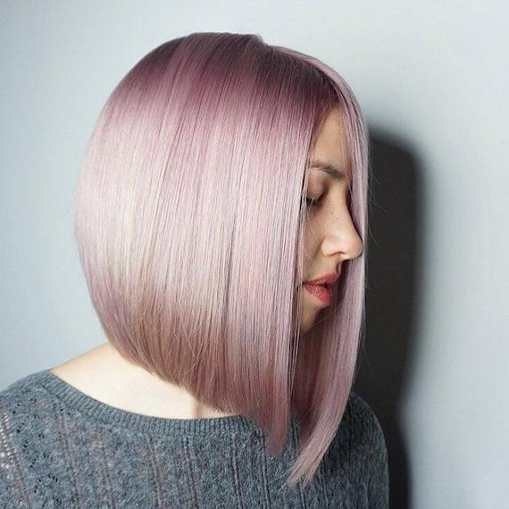 Woman with short, pink bob, created using Wella Professionals