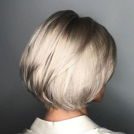 Woman with short, blonde, layered bob, created using Wella Professionals