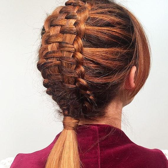 Back of woman's head with copper tapestry braid, created using Wella Professionals.