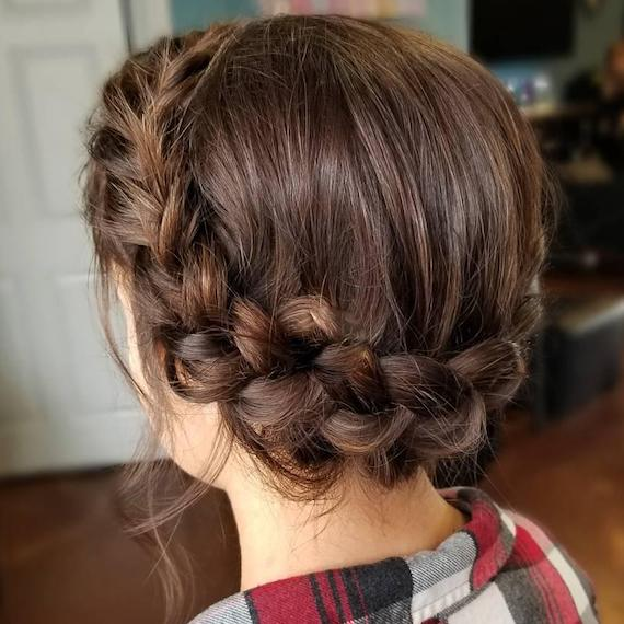 Back of woman's head with brunette crown braid, created using Wella Professionals.