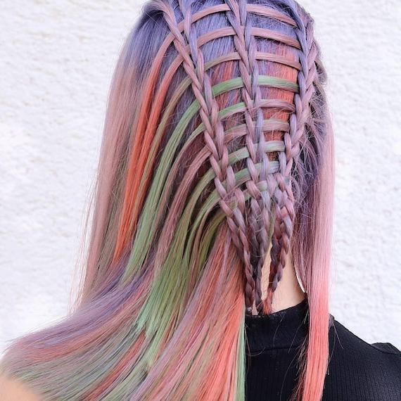 Back of woman's head with rainbow braid, created using Wella Professionals.