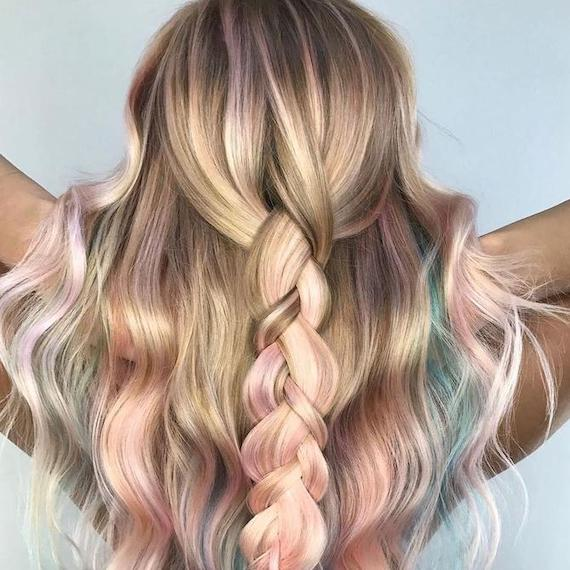 Back of woman's head with wavy, pastel hair in a half-up braid, created using Wella Professionals.