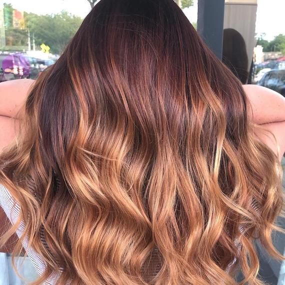 Back of woman's head with coppery bronde hair, created using Wella Professionals.