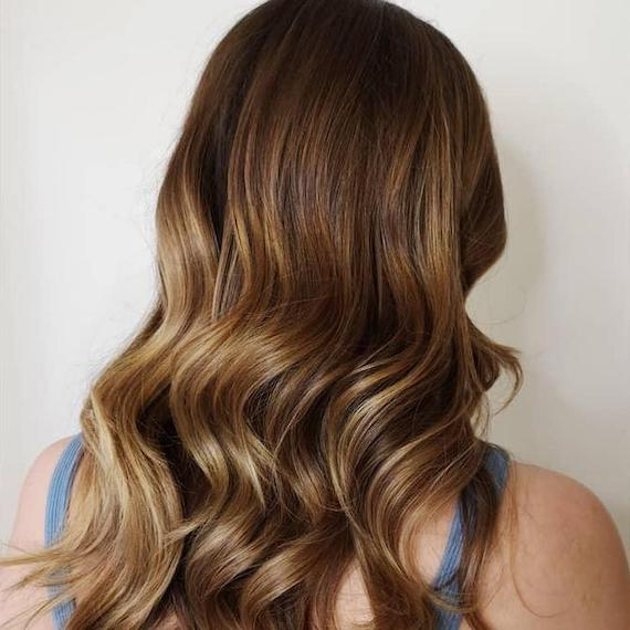 Back of woman's head with light brown hair and balayage, created using Wella Professionals