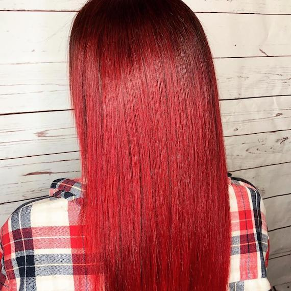 Photo of long, straight, cherry red ombre hair, created using Wella Professionals.