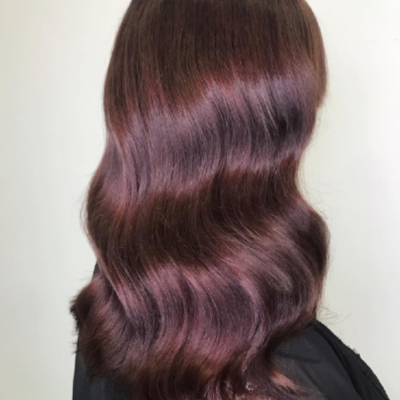Woman with long, chestnut red brown hair,  created with Wella Professionals