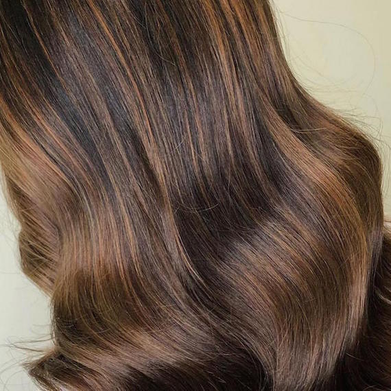 Close-up of brown hair with balayage, created using Wella Professionals.