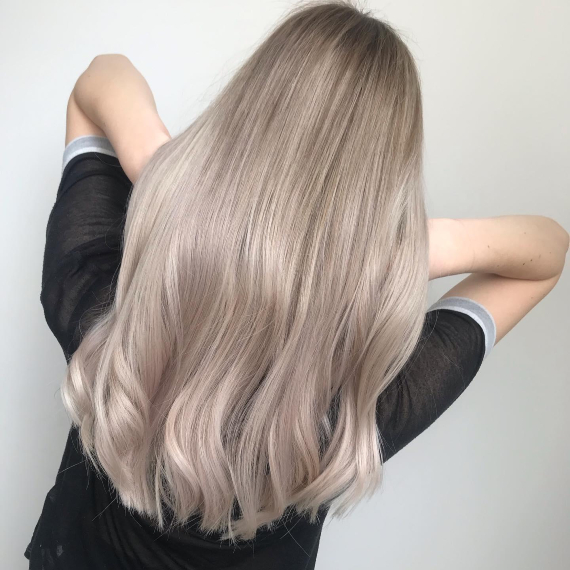 back of woman's head with long ash blonde hair & ice blonde lowlights