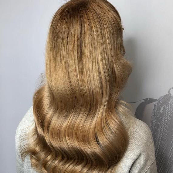 Photo of the back of a woman's head with light golden brown hair, created using Wella Professionals.
