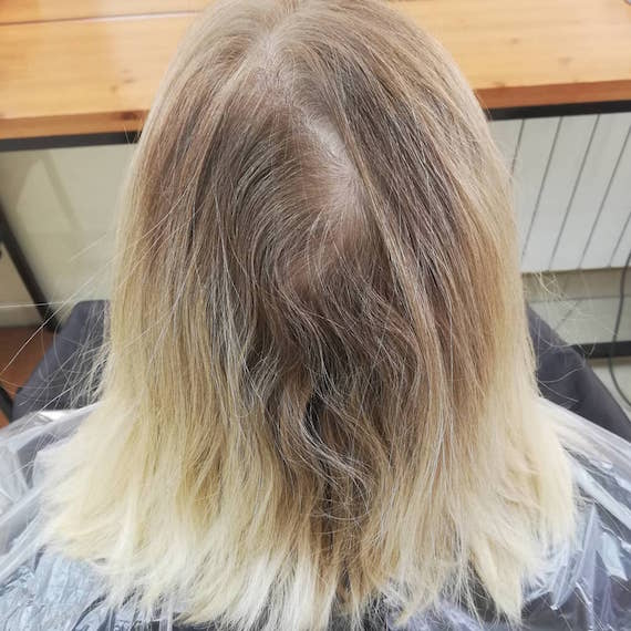 Photo of blonde bob with deep gray roots.