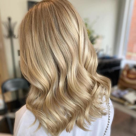 Photo of woman with mid-length, blonde hair, created using Wella Professionals.