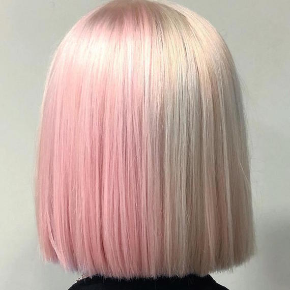Back of woman's head with half and half hair color in pastel pink and vanilla blonde, created using Wella Professionals.