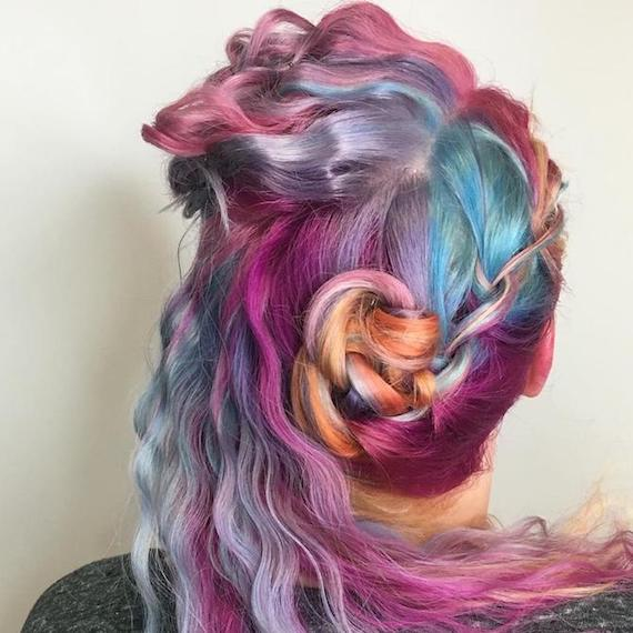 Back of a woman's head showing crimped rainbow hair inspired by unicorns, created using Wella Professionals.